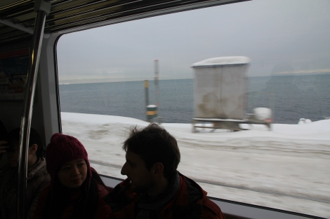 The 30-minute train ride to Otaru wraps around the coast providing chilly views of the ocean flanked by snow banks